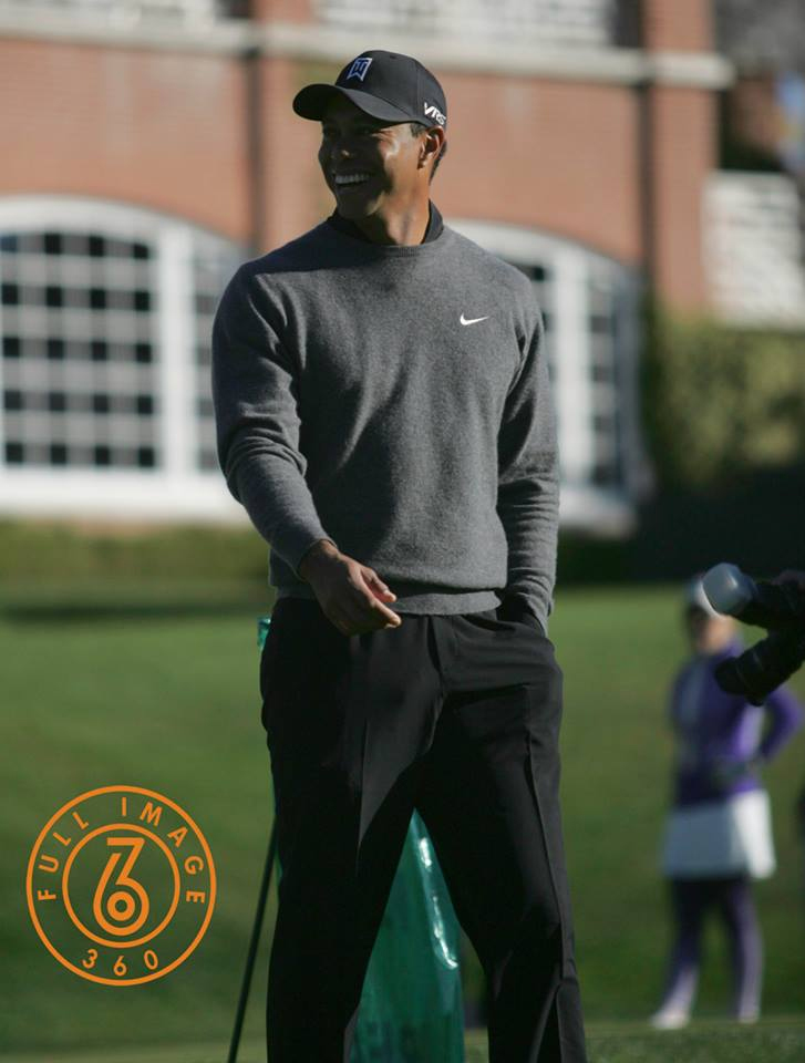 Tiger All Smiles on Practice Green Before Starting a Round. Photo by Jevone Moore