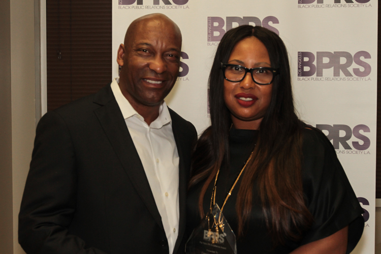 Honoree Cassandra Butcher with Filmmaker John Singleton