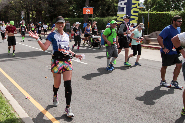 Racer May Hui all smiles at mile 23