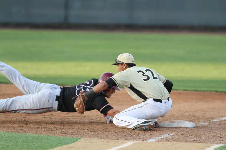 Cal State LA first baseman Paul Martinez Jr. on the tag after Chico State Tyler Madrid slides safe. Photos by Jevone Moore / Full Image 360