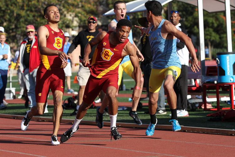 SC  Davonte Stewart receives baton from Andre De Grasse just ahead of UCLA  Joe Herrera