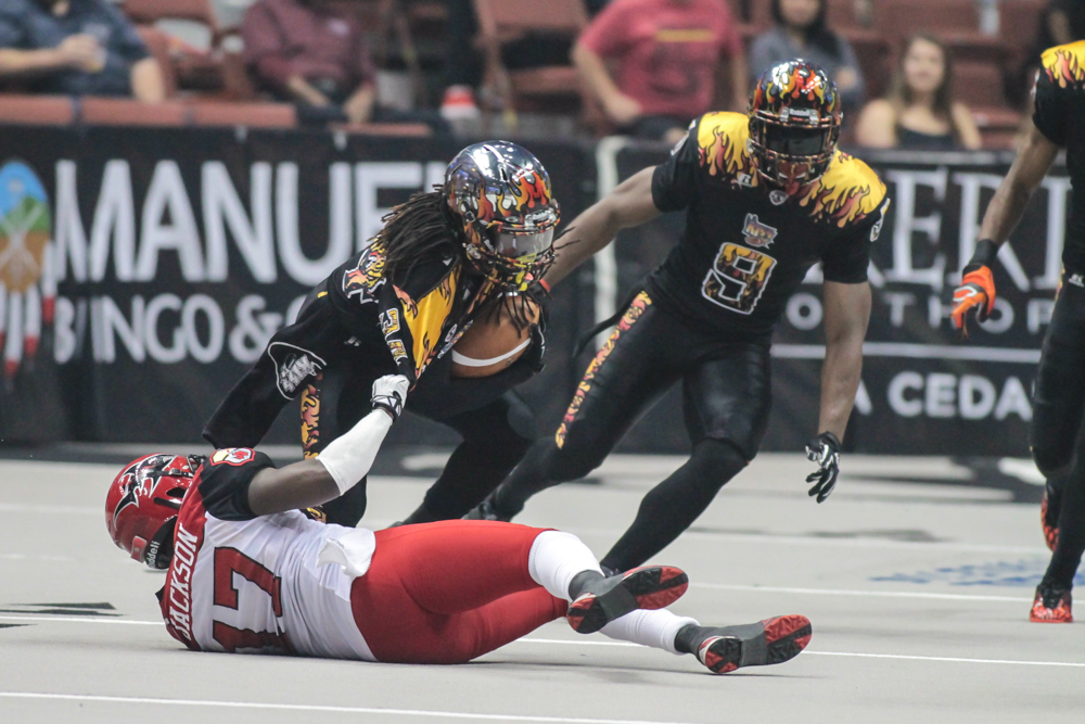 New Kick returner Laron Scott pulling away in 3rd quarter on a big return. Photo by Jevone Moore