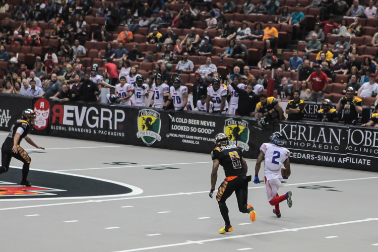 Portland Thunder explosive kick returner / wide receiver flying past the kickoff team. Photo by Jevone Moore