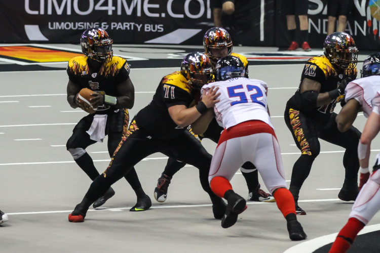 LA Kiss QB Adrain McPherson dropping back in pocket feeling comfortable. Photo by Jevone Moore