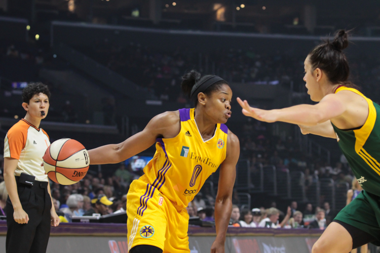 LA Sparks leader Alana Beard driving on Jenna O'Hea in first half. Photo by Jevone Moore