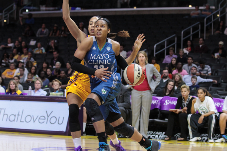 Maya Moore just barley gets past Jennifer Lacy on  drive to basket in the 2nd qtr. Photo by Jevone Moore