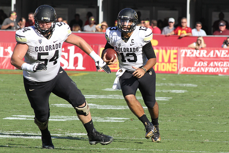 QB Sefo Liufau following his blocking. Photo by Jevone Moore