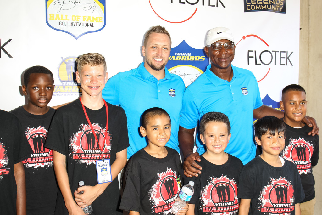 Eric Dickerson & Jason Hill and bunch of Young Warriors. Photo by Jordon Kelly