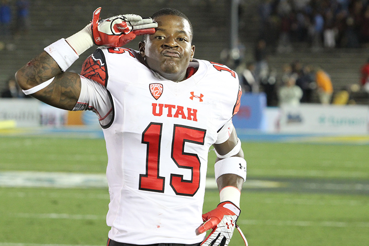Dominique Hatfield giving a salute after 30-28 win at Ucla.