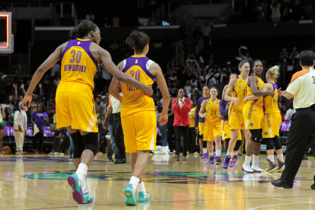 Ogwumike and Toliver leaving floor pumped after the victory. Photo by Jevone Moore