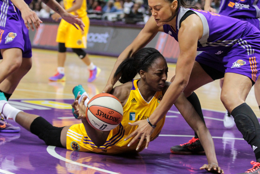 Nneka Oqwumike getting after loose ball. Photo by Jevone Moore