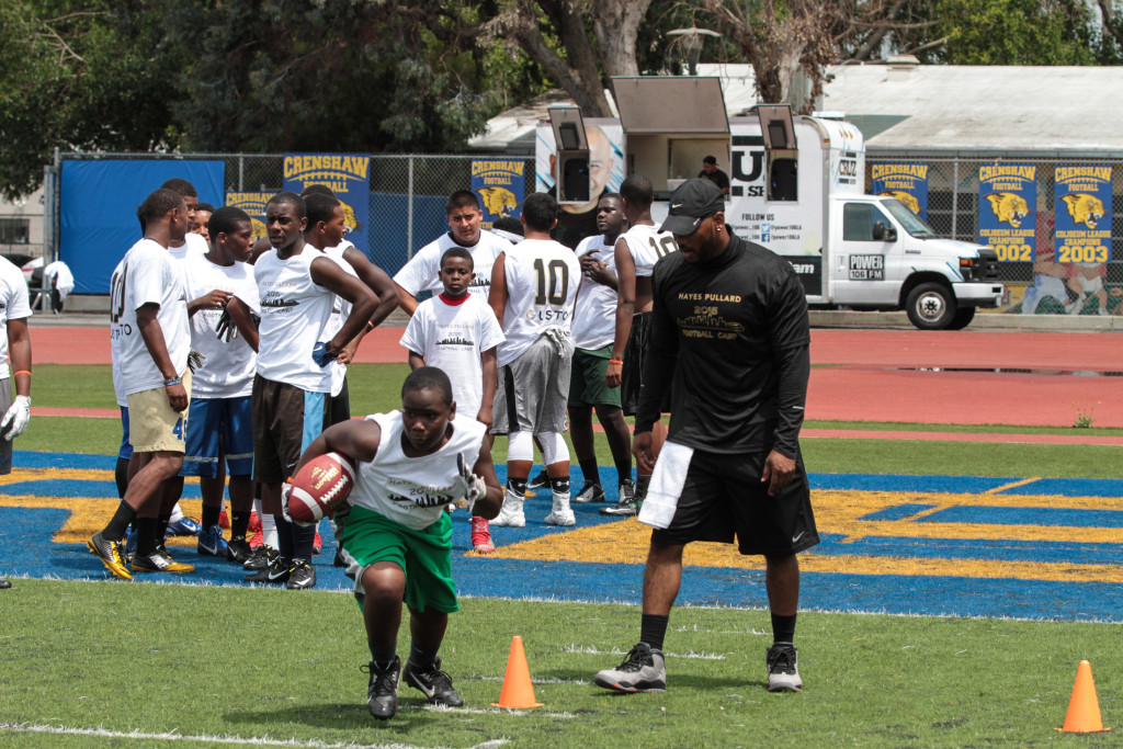 Camper Marcus Higgs digging during RB cone drills. Photo by Jevone Moore