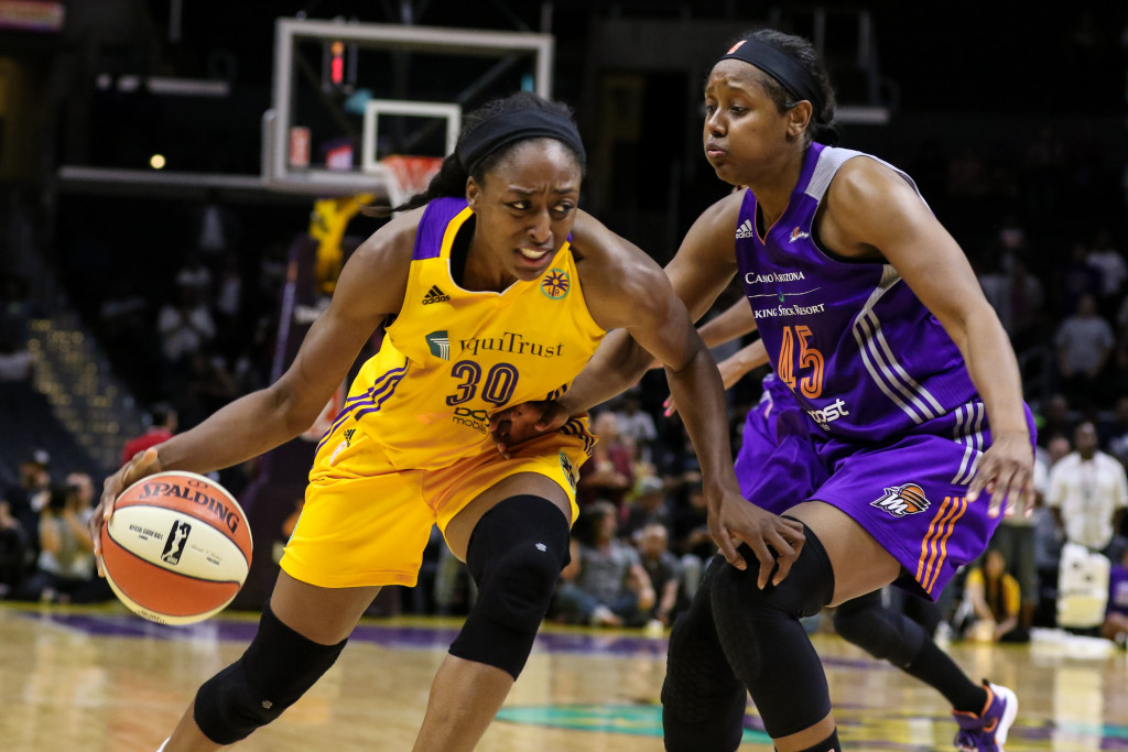 Sparks Nneka Ogwumike driving on Mercury's Noelle Quinn. Photo by Jevone Moore