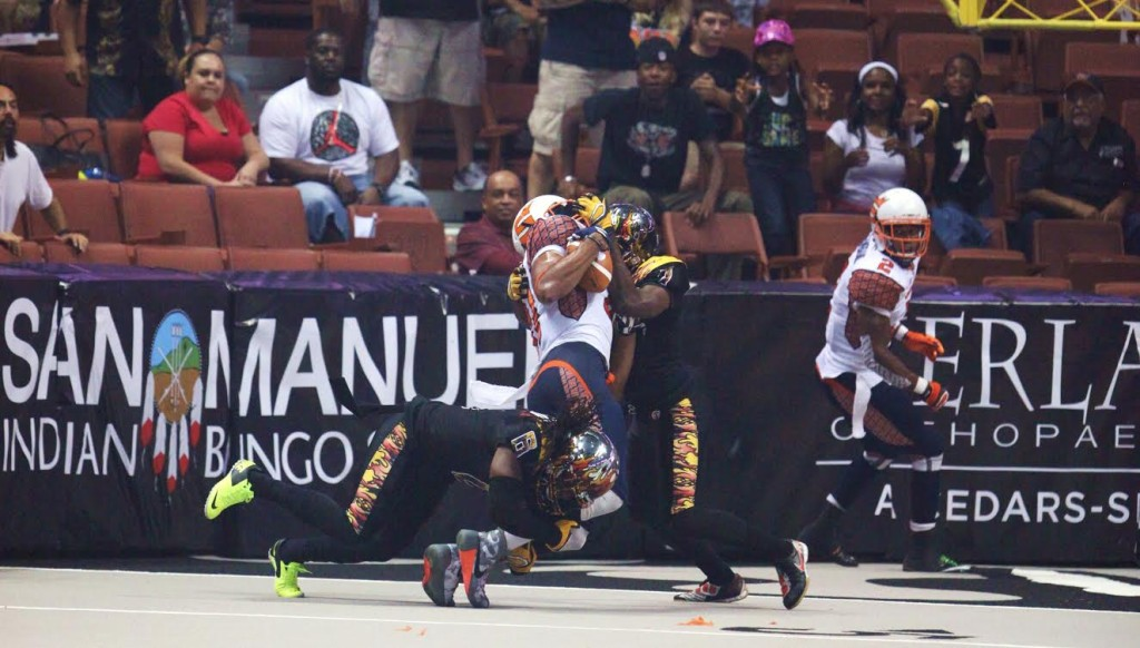 "LA Kiss Defenders Rayshaun Kizer (7) & Josh Victorian (6) converge on the receiver. Photo by William ""Jaye"" Johnson"