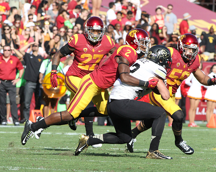 DB Adoree' Jackson on the tight defensive with the tackle. Photo by Jevone Moore