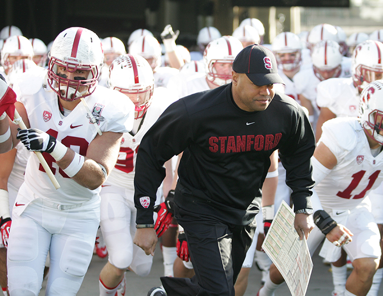 Coach Shaw leading his team on to field at 100th Rose Bowl. Photo by Jevone Moore