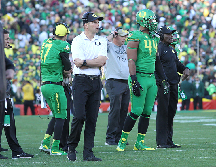 Head Coach Helfrich on sideline at the Rose Bowl. Photo by Jevone Moore