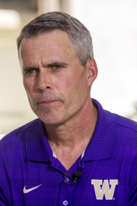 Washington Head Coach Chris Petersen Pondering over a question at Pac 12 Media day 2014. Photo by Jevone Moore