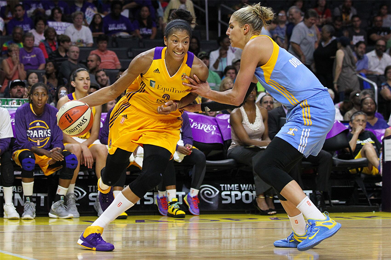Candace Parker battling on the drive against Elena Delle Donne. Photo by Jordon Kelly