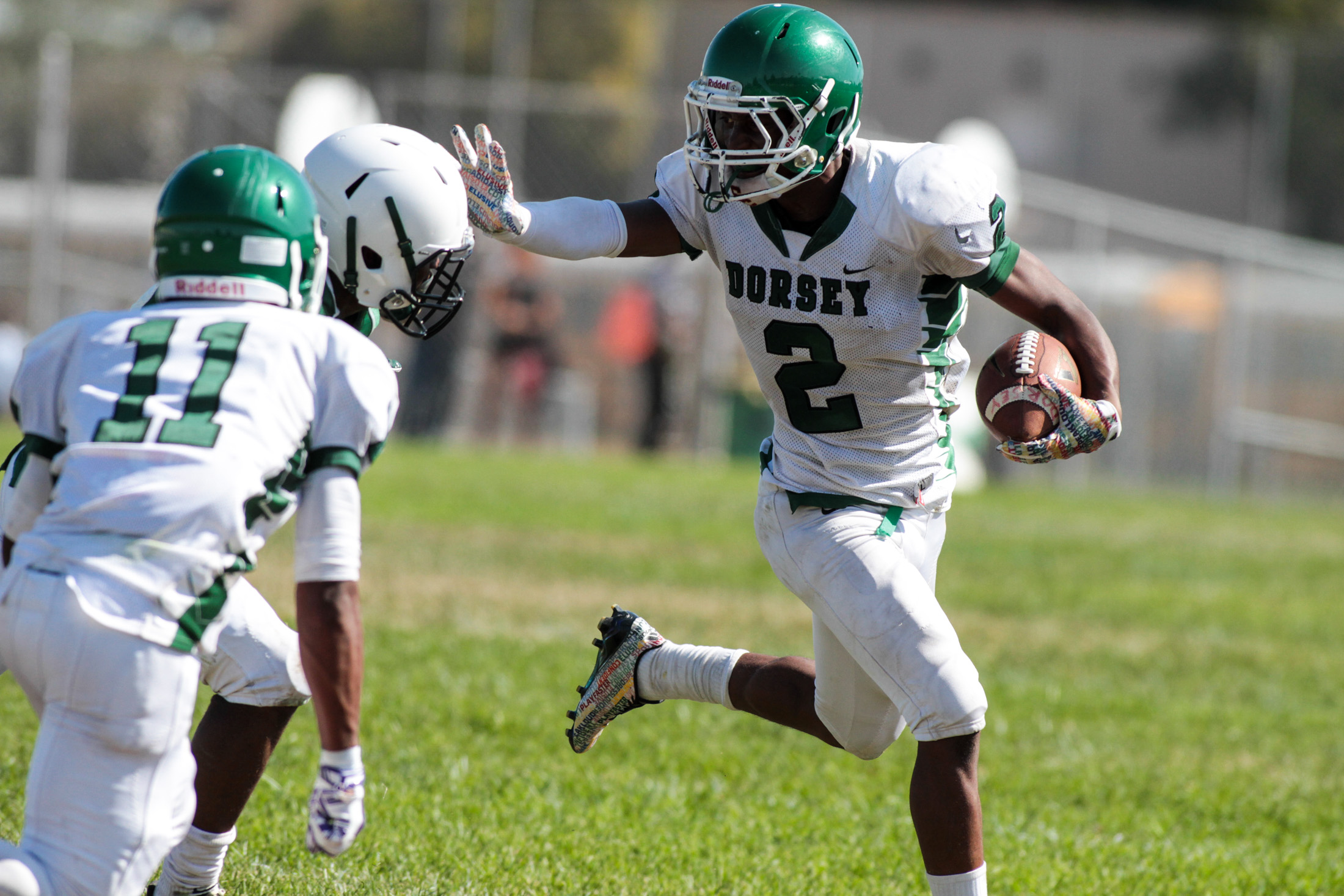 Dorsey Dons Running Back Parie Dedeaux with stiff arm to turn corner. Photo by Jevone Moore