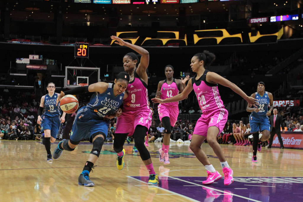 Alana Beard on tight defense of Maya Moore with Kristi Tolver there for help. Photo by Jevone Moore