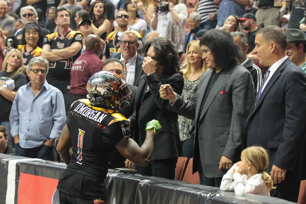 Donovan Morgan celebrates with Kiss Owners Paul Stanley & Gene Simmons after a touchdown. Photo by Jevone Moore