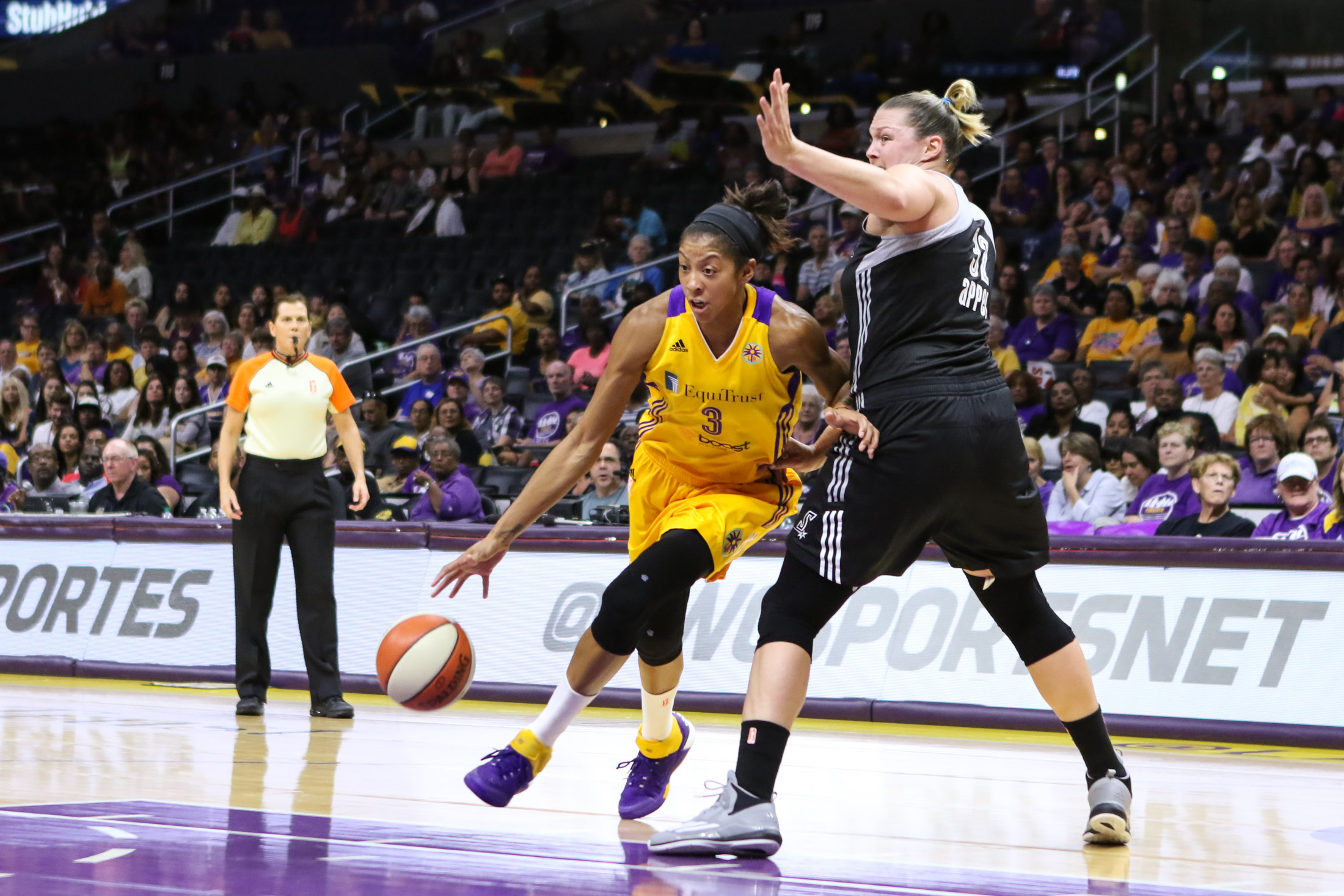 Los Angeles Sparks Candace Parker finding a hole in the defense. Photo by Jevone Moore