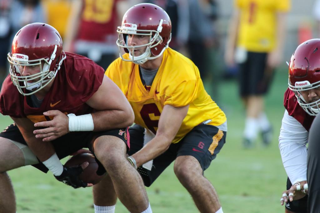 QB Cody Kessler taking snap from center Max Tuerk. Photo by Jevone Moore