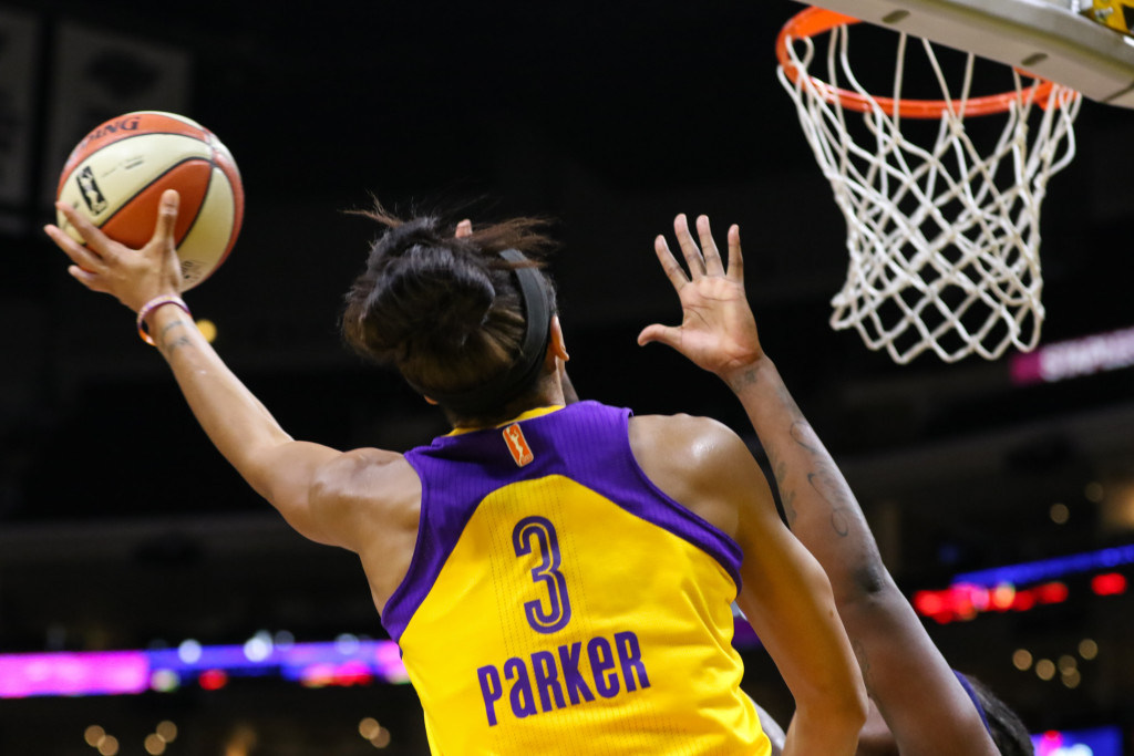Candace Parker flying high at rim for a basket. Photo by Jevone Moore