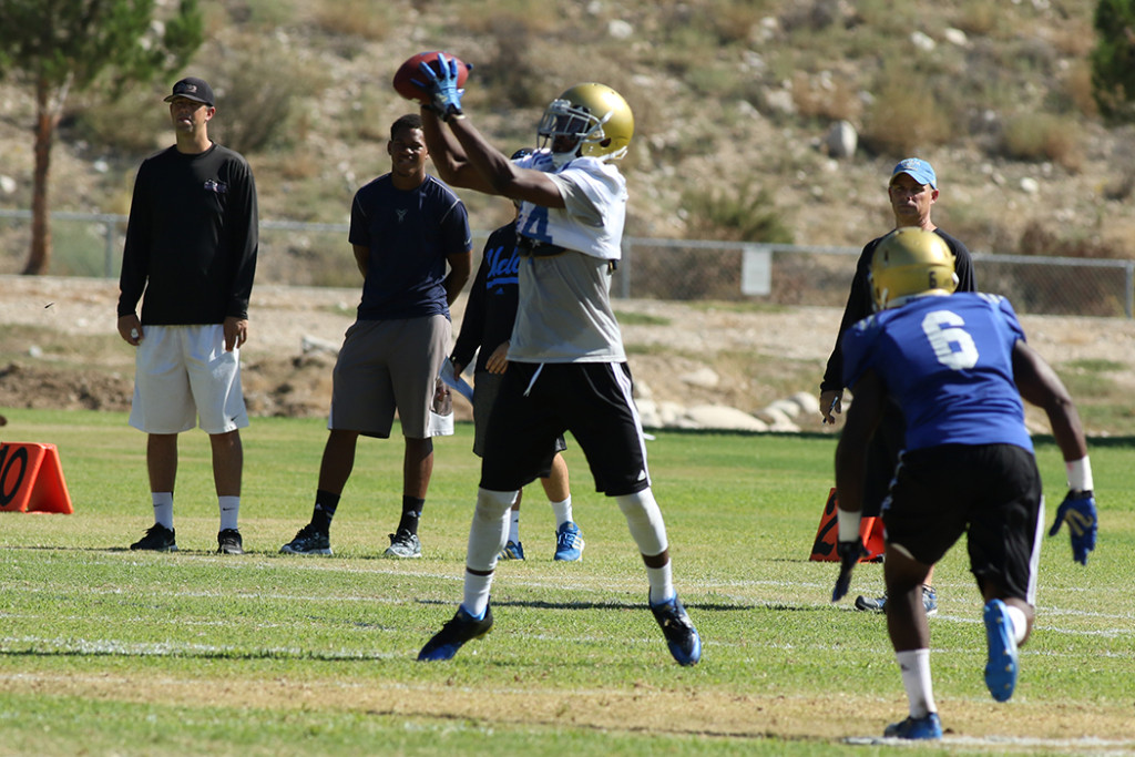 Wide Receiver Mossi Johnson on the catch. Photo by Jevone Moore