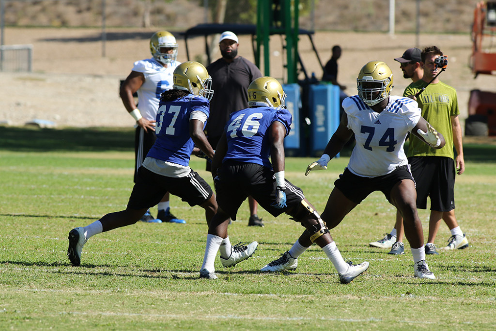 Linebackers Dwight Williams (37) & Kene Orjioke (46) ready to attack. Photo by Jevone Moore