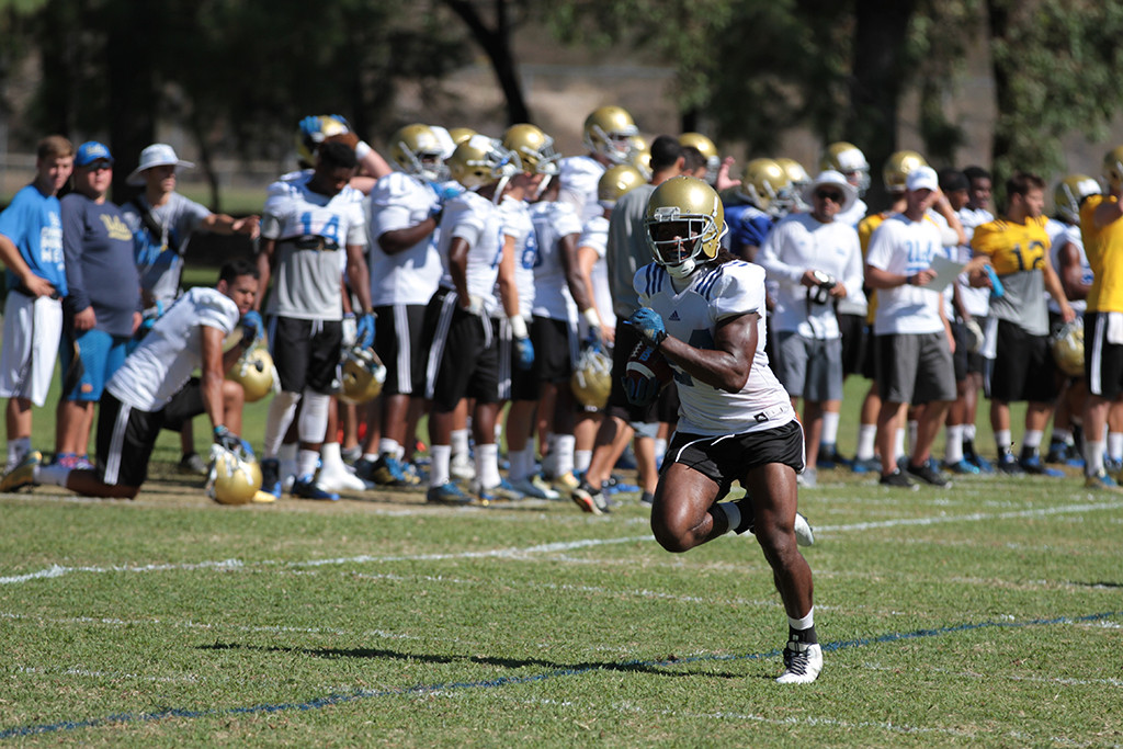Ucla Running back Paul Perkins running for daylight. Photo by Jevone Moore