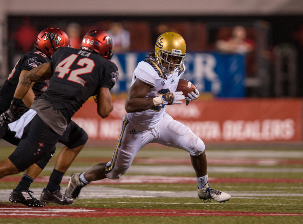 Paul Perkins find the edge 151 yards 2 TD's. Photo by Juan Lainez