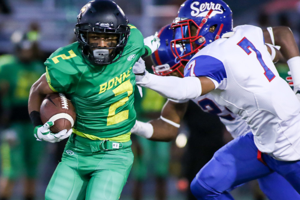 Narbonne RB Sean Riley breaking away from arm tackles. Photo by Jevone Moore