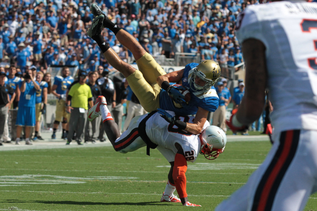 Ucla Receiver Logan Sweet selling all out for the catch. Photo by Jevone Moore