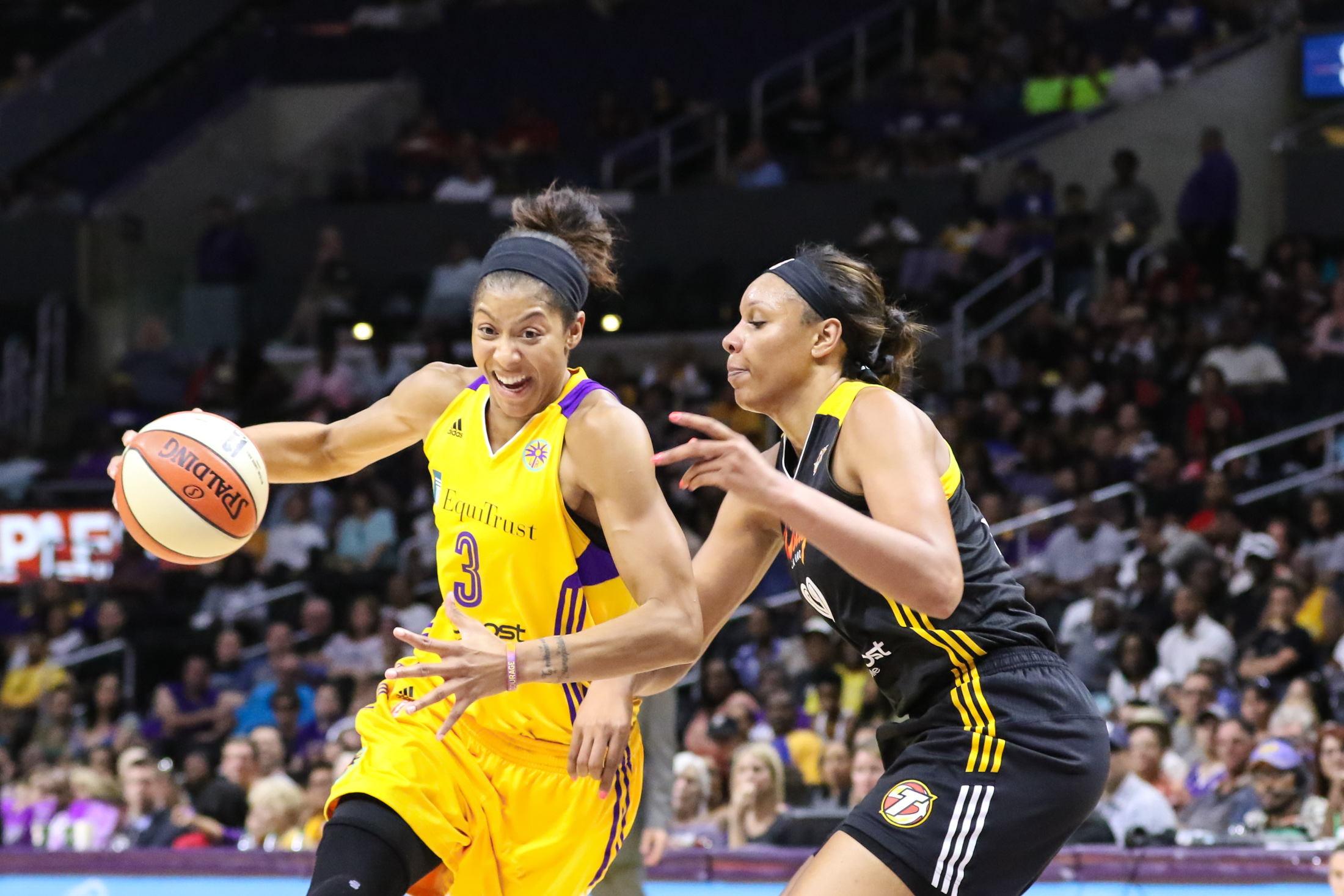 Candace Parker driving on Plenette Pierson of the Shock. Photo by Jevone Moore