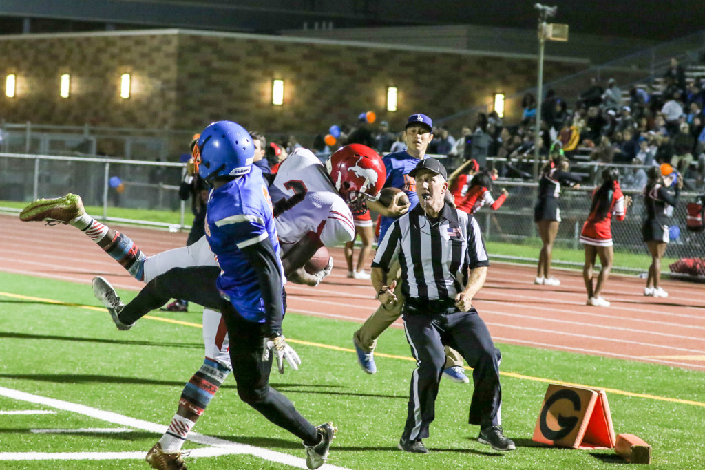 MVP Adarrus Wilson come down with a Touchdown over Eugene Ford. Photo by Jevone Moore
