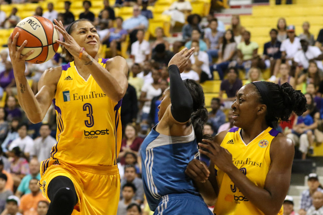 Candace Parker driving to the basket. Photo by Jevone Moore