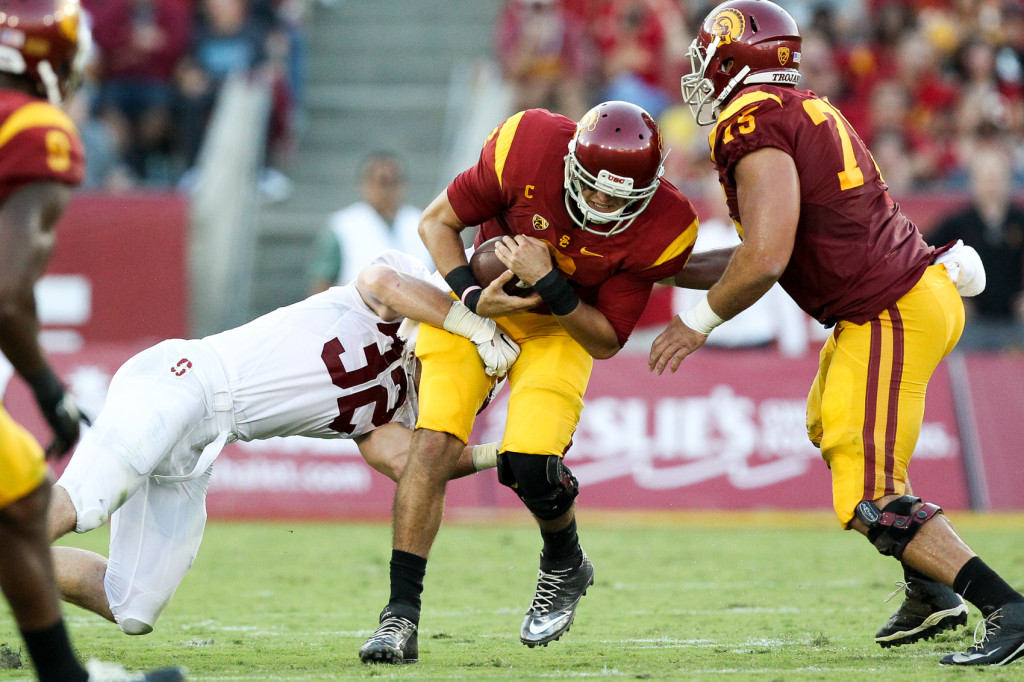 USC Cody Kessler under pressure by Stanford. Photo by Jordon Kelly