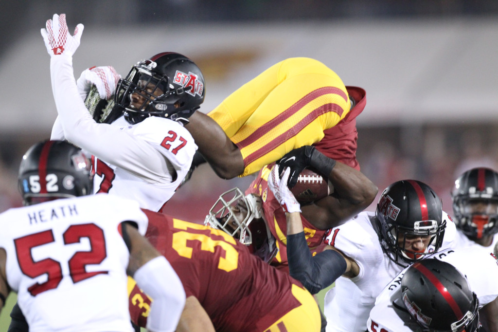 Adoree Jackson flying high on punt return. Photo by Jordon Kelly