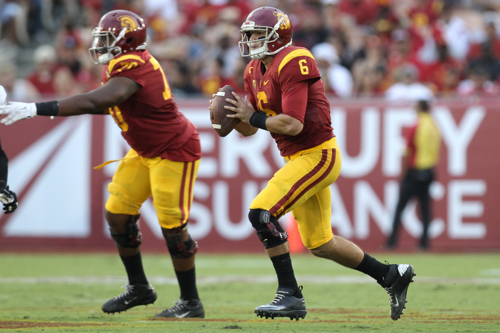 Cody Kessler back to pass on a 410 yard 3 TD's performance. Photo by Jordon Kelly
