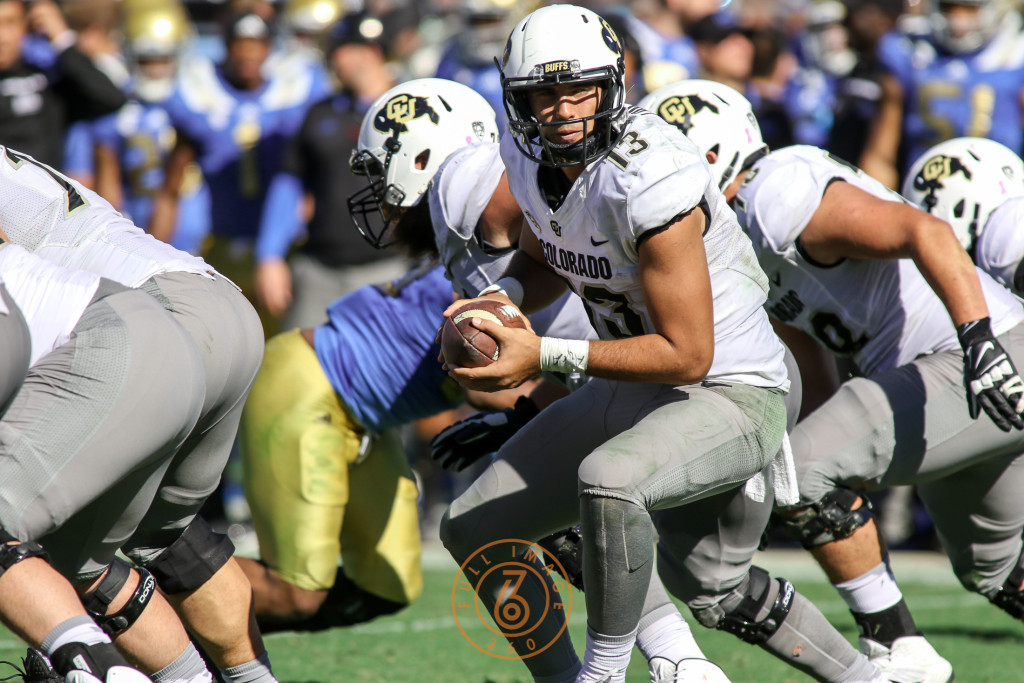 Oct. 31, 2015 - Pasadena, CA, USA - Colorado Buffalo qb Sefo Liufau about to hand off in the second half of the Colorado vs UCLA game at Rose Bowl Saturday Oct. 31, 2015 in Pasadena, California. (Photo by Jevone Moore/Full Image 360)