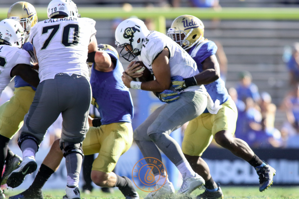 Oct. 31, 2015 - Pasadena, CA, USA - Ucla Bruin defense sacking Colorado Sefo Liufau (13) in the second half of the Colorado vs UCLA game at Rose Bowl Saturday Oct. 31, 2015 in Pasadena, California. (Photo by Jevone Moore/Full Image 360)