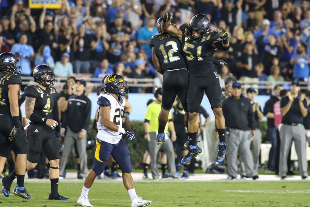 October 22 2015: UCLA Bruins Defenders Jayon Brown (12) & Aaron Wallace (51) celebrate after a sack during the game between Cal and UCLA at Rose Bowl in Pasadena, CA. (Photo by Jevone Moore / Full Image 360)