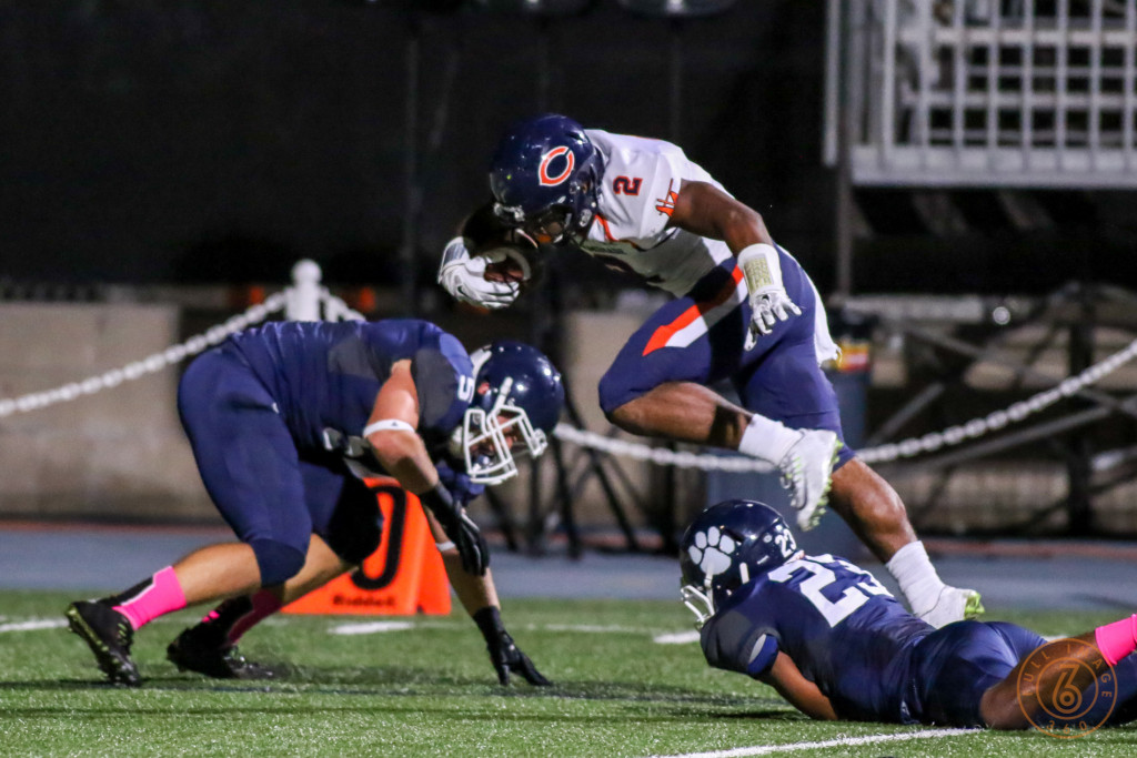 Tj Pledger hurdling Cubs to set up 1Q Touchdown. Photo by Jevone Moore