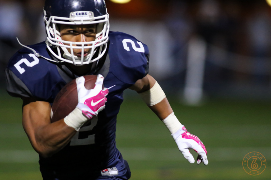Drake Beasley Showing off Breast Care Awareness Gloves. Photo by Jevone Moore