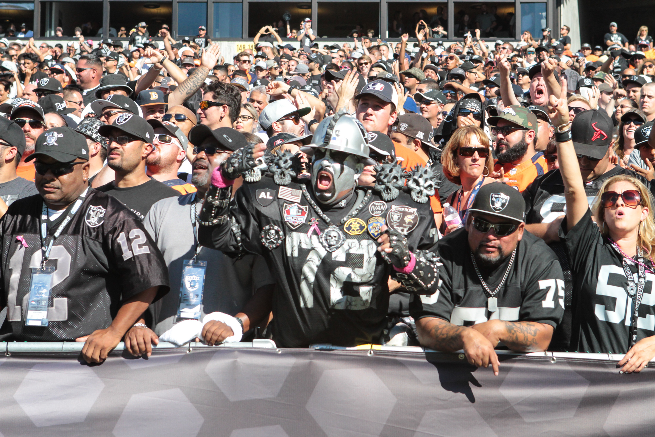 11 October 2015: Oakland Raiders fans during action in an NFL game with the Denver Broncos at O.co Coliseum in Oakland, CA. The Broncos won 16-10.(Photograph by Jevone Moore / Full Image 360)