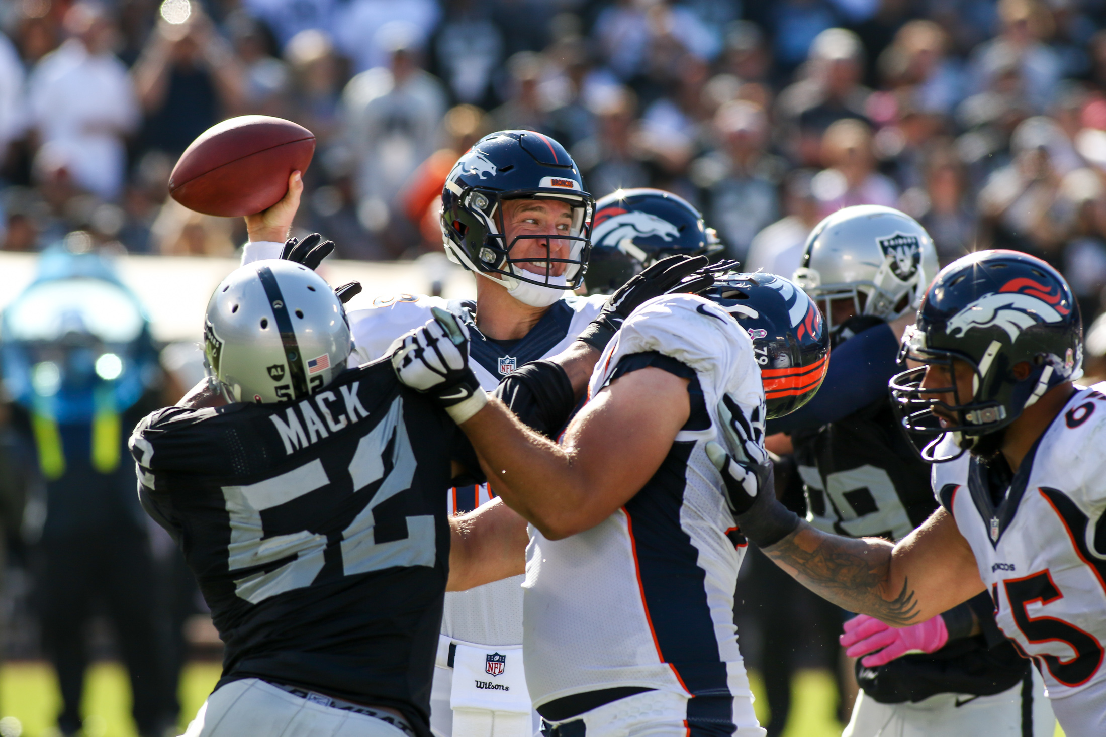 11 October 2015: Denver Broncos quarterback (18) Peyton Manning standing tall in the pocket during an NFL game against the Oakland Raiders at O.co Coliseum in Oakland, CA. The Broncos won 16-10.(Photograph by Jevone Moore / Full Image 360)