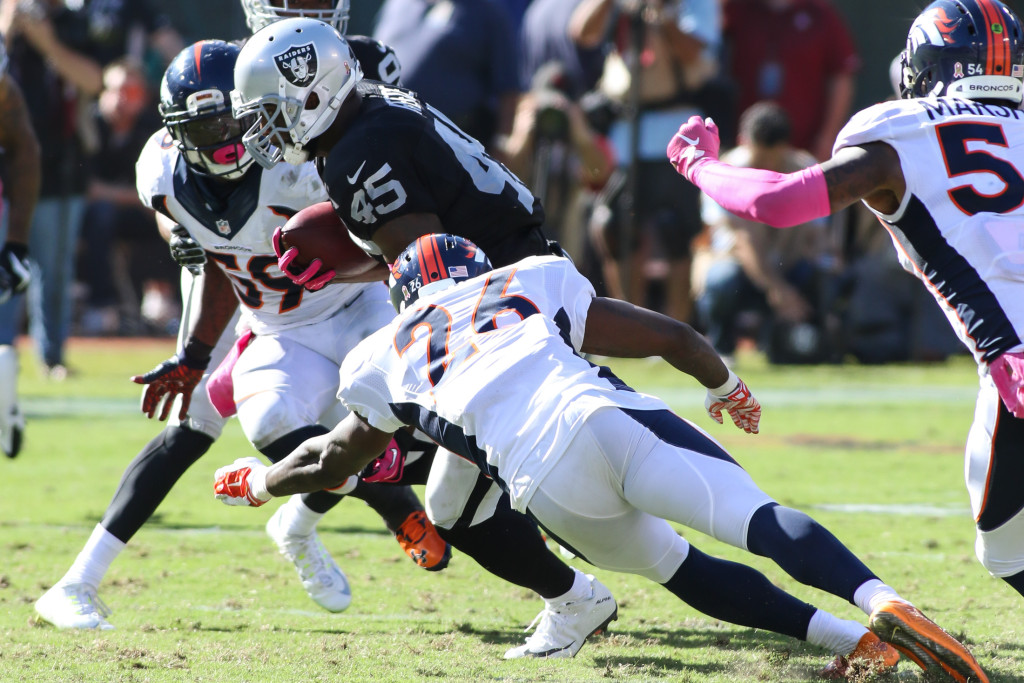 11 October 2015: Oakland Raiders fullback (45) Marcel Reece picking up few tough yardsduring action in an NFL game with the Denver Broncos at O.co Coliseum in Oakland, CA. The Broncos won 16-10.(Photograph by Jevone Moore / Full Image 360)