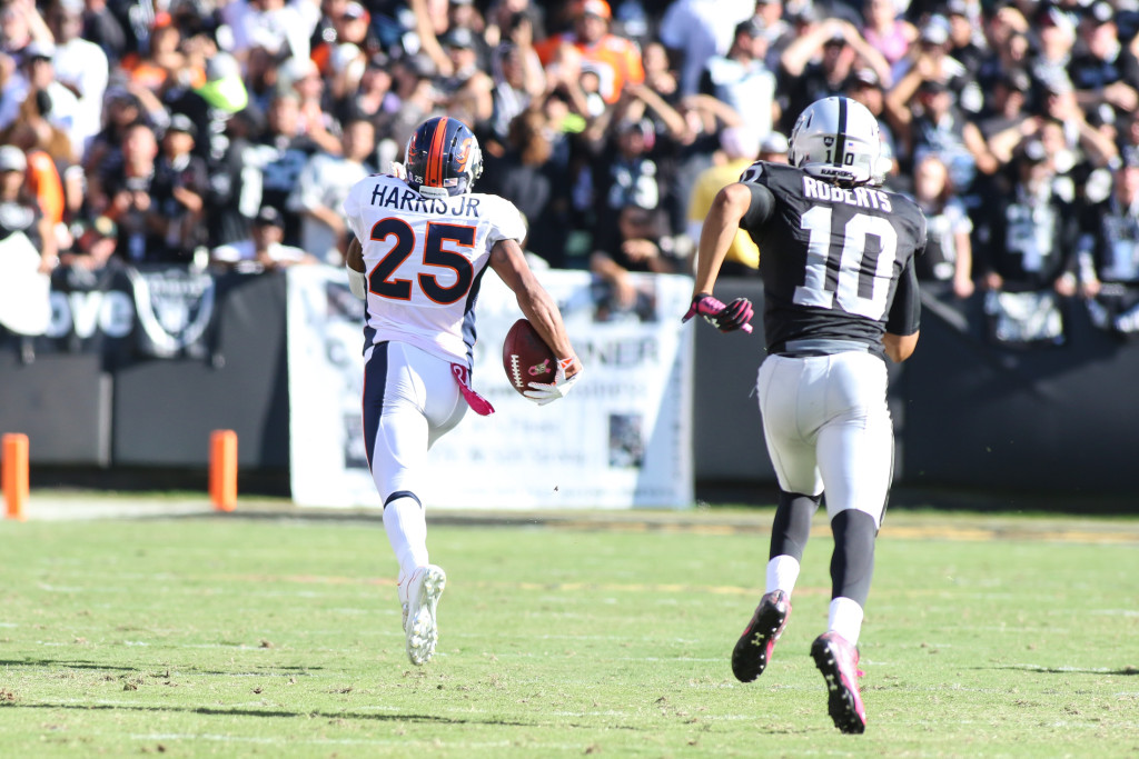 11 October 2015: Denver Broncos cornerback (25) Chris Harris Jr during game sealing interception for a touchdown during an NFL game against the Oakland Raiders at O.co Coliseum in Oakland, CA. The Broncos won 16-10.(Photograph by Jevoone Moore / Full Image 360)